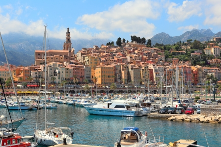 Colorful houses, church and marina with yachts and boats in Menton - town on French Riviera in France Stock Photo - 18256154