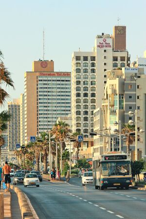 TEL AVIV - JULY 01: View of central street with cars and bus along seafront and row of hotels which are among largest and most popular resorts on Mediterranean sea for tourists visiting israeli coast in Tel Aviv, Israel on July 01, 2009. Stock Photo - 18368588