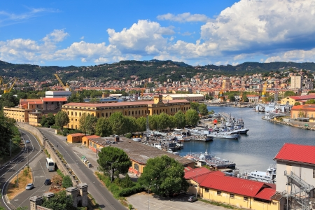 View on harbor with military navy base and city of La Spezia in Liguria, Italy