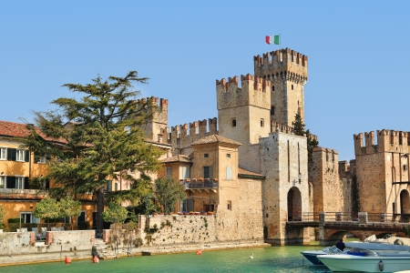 View on famous medieval Scaliger castle in town of Sirmione on Lake Garda in Northern Italy