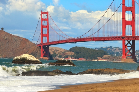 bay area: View of famous red Golden Gate Bridge as seen from Baker beach in San Francisco, USA  Stock Photo