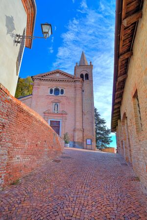 Vertical image of  red brick church and narrow cobblestone street in at medieval part of the town in Monticello D Stock Photo - 19114219