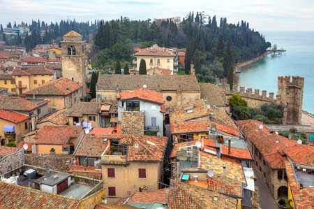 sirmione: View from above on typical old houses with red roofs of Sirmione - town on Lake Garda in Italy  Stock Photo