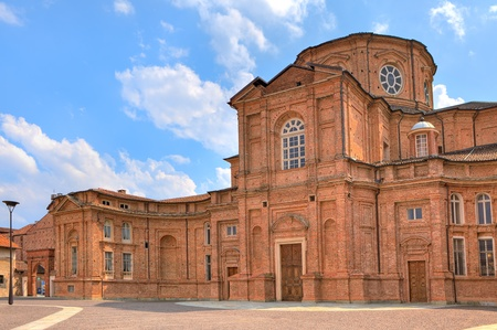reale: Red brick church as part of Palace of Venaria complex located near Turin in Piedmont, Northern Italy