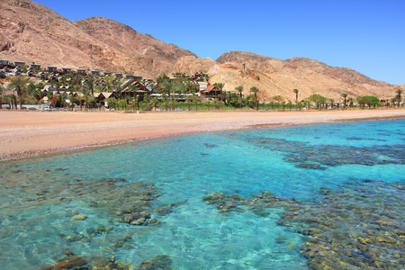 Horizontal oriented image of beautiful Red Sea shoreline and red mountains in Eilat, Israel  photo