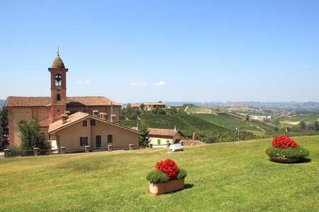 cavour: View on old church and green lawn in Grinzane Cavour - small town in northern Italy  Stock Photo