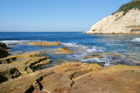 Rocks and white chalk cliff at Rosh HaNikra reserve on Mediterranean sea in Israel  photo