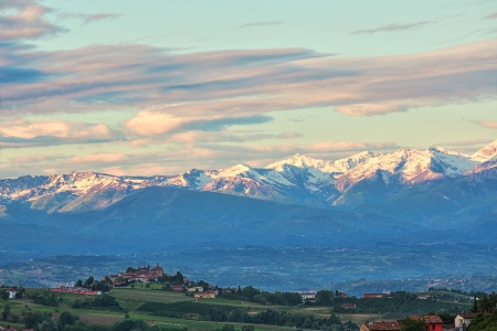 early spring snow: View of small town on the hill at the foothills of the Alps in Piedmont, Northern Italy