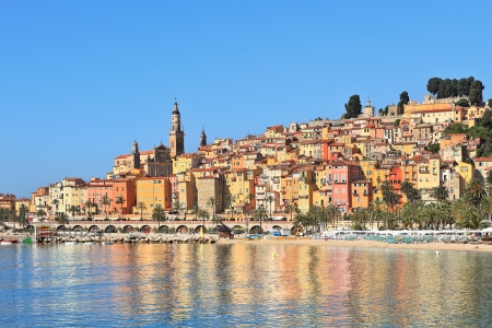 cote d'azur: View on colorful houses of old town of Menton under blue sky on french riviera in Southern France  Stock Photo