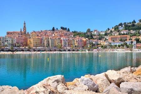 maritimes: View of coastline and multicolored houses of small town of Menton Stock Photo