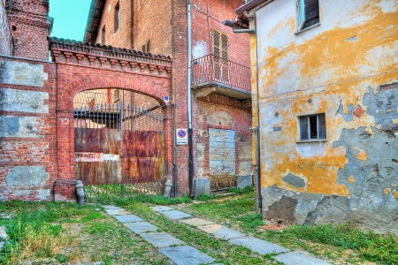 abandoned city: Small courtyard at thr entrance to old abandoned warehouse in small italian town