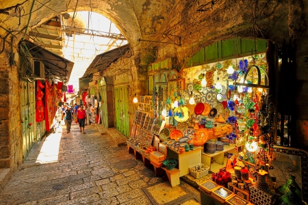 bazar: JERUSALEM, ISRAEL - AUGUST 21  Covered oriental market in old city of Jerusalem offering variety of middle east traditional products and souvenirs  Market is very popular site with tourists and pilgrims visiting the city in Jerusalem, Israel on August 21,
