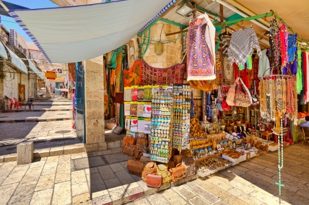 middle east: JERUSALEM, ISRAEL - AUGUST 21  Famous market in old city of Jerusalem offers variety of middle east traditional products and souvenirs  Market is very popular site with tourists and pilgrims visiting the city in Jerusalem, Israel on August 21, 2013