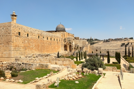 holyland: Minaret and dome of Al-Aqsa Mosque surrounded by walls and ancient ruins in Old City of Jerusalem, Israel