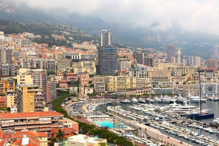 carlo: View of marina with yachts and modern urban buildings in Monte Carlo, Principality of Monaco  Stock Photo