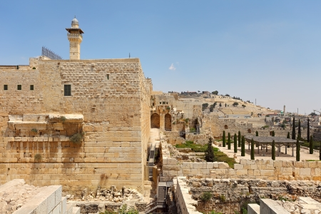 holyland: Minaret of Al-Aqsa Mosque surrounded by walls and ancient ruins in Old City of Jerusalem, Israel