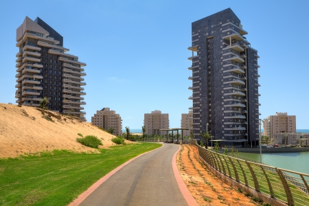 ashdod: Running track and two modern residential building in city park of Ashdod, Israel