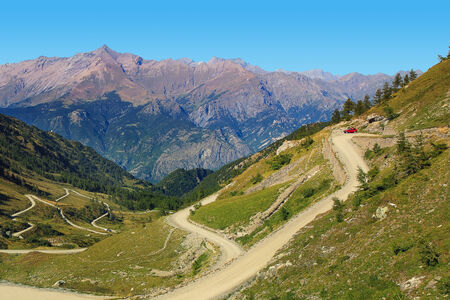 unpaved road: Unpaved road among slpes of hills and mountains in Piedmont, Northern Italy  Stock Photo