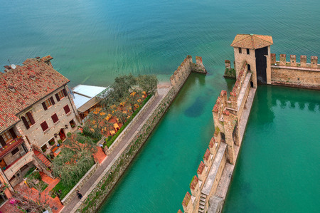 garda: Fragment of surrounding wall of medieval Scaliger castle situated on Lake Garda in Italy  view from above