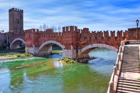 Famous red brick Castelvecchio bridge across Adige river in Verona, Italy