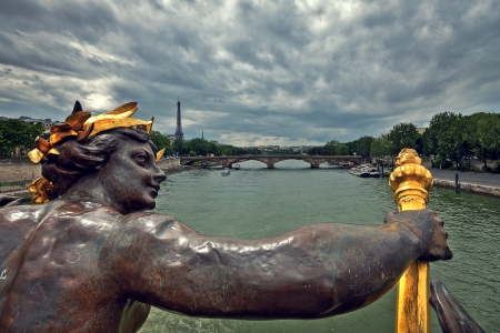 alexander: View of Seine River and Eiffel Tower from famous Alexander the III bridge in Paris, France  Stock Photo