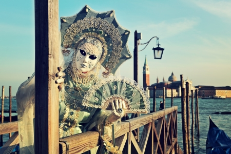 participant: VENICE, ITALY - MARCH 04  Unidentified participant in mask and costume during traditional famous Venetian Carnival on March 04, 2011 in Venice, Italy  Editorial