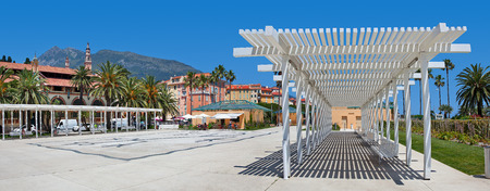 azur: Panorama of central plaza and old town of Menton - popular resort on French Riviera in France