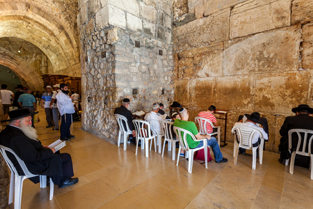 JERUSALEM, ISRAEL - AUGUST 21, 2013  Prayers inside the Cave Synagogue which is a part of Western Wall  aka Wailing Wall  - Judaism