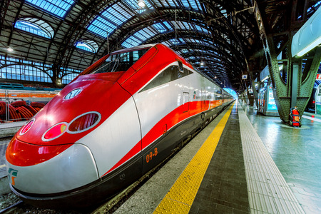MILAN, ITALY - JUNE 07, 2012  Trenitalia Frecciarossa  red arrow  on Milan Central Station  This high speed train can reach 300 km h and operate Turin-Milan-Bologna-Florence-Rome-Naples route
