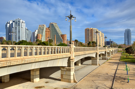 river bed: Bridge across former river bed of Turia towards contemporary hotel and residential buildings in Valencia, Spain  Stock Photo