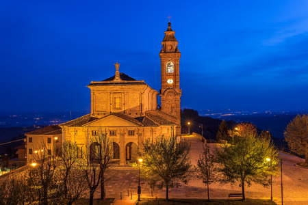 Illuminated church on town square early in the morning in Piedmont, Northern Italy  photo