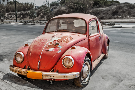 ASHKELON, ISRAEL - AUGUST 26, 2013  Old bad conditioned Volkswagen Beetle on the street  It is economy car produced in Germany from 1938 until 2003 and officially called Volkswagen Type 1  informally Volkswagen Bug   Stock Photo - 27731612