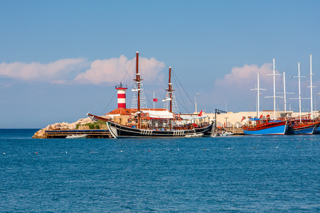 Sailing ships in small harbor of Kemer - tourist resort on Mediterranean sea in Turkey  photo