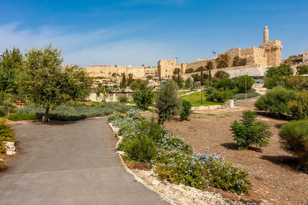 Tower of David and ancient City walls as seen from urban park in Jerusalem, Israel