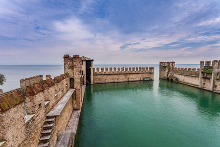 sirmione: Medieval walls of town of Sirmione on Lake Garda in Italy  Stock Photo
