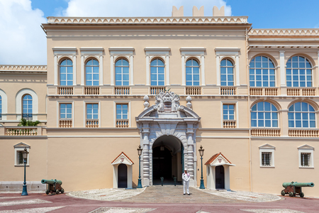 MONACO-VILLE, MONACO - JULY 13, 2013  Facade of official residence of Prince of Monaco and security guard at the entrance   Palace Guards group created in 1817, provide security for Palace, residence, Prince and his family