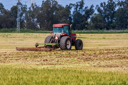 israel agriculture: Tractor plowed agricultural field after wheat cropping in Israel