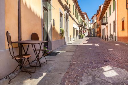 cobblestone street: Restaurant in italy  Stock Photo