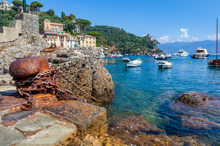 Old rusty bollard wirh marine chain on remains of old port in Portofino, Italy  Stock Photo