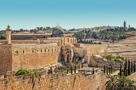 Minaret and dome of Al-Aqsa Mosque surrounded by ancient walls in Jerusalem, Israel. photo