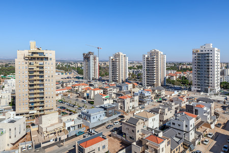 residential neighborhood: Modern private houses and contemporary multistorey residential buildings in the new neighborhood of Kiryat Gat - city in southern district of Israel.