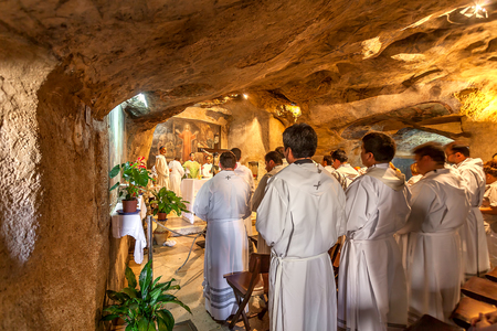 franciscan: JERUSALEM, ISRAEL - JULY 13, 2014: Franciscan monks pray in Grotto of Gethsemane - chapel located in the cave near Tomb of the Virgin. This is the place where Judas Iscariot betrayed Jesus. Editorial