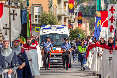 carabineer: ALBA, ITALY - OCTOBER 05, 2014: Warriors in historic dresses and carabiniers on background march through streets of Alba during traditional annual Medieval Parade.