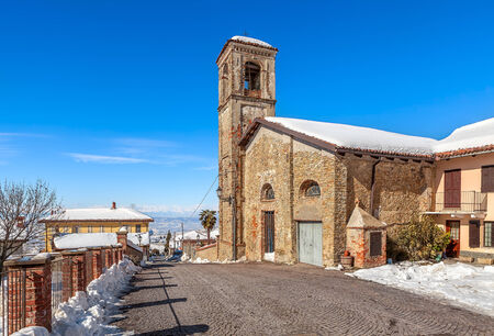 Old brick church in small town of Montelupo Albese in Piedmont, Northern Italy. photo