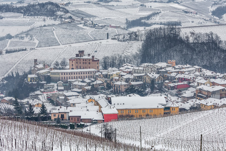 wintery snowy: Small town of Barolo among hills of Langhe covered with snow in Piedmont, Northern Italy. Stock Photo