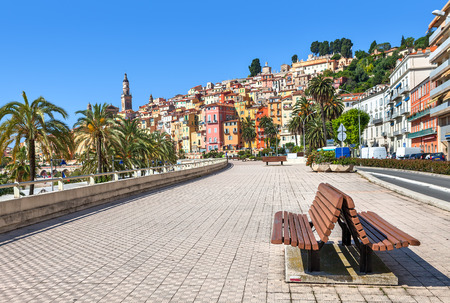 alpes maritimes: Promenade along streets and colorful houses of Menton - town and touristic resort on French Riviera. Editorial