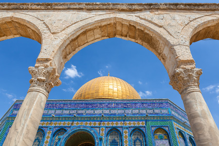 dome of the rock: Ancient arch and Dome of the Rock Mosque under blue sky in Jerusalem, Israel.