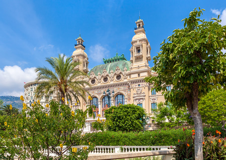 monte: MONTE CARLO, MONACO - JULY 13, 2013: Salle Garnier - gambling and entertainment complex designed by architect Charles Garnier, opened in 1879, includes famous Casino and opera house.