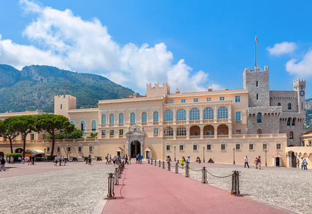 MONACO-VILLE, MONACO -  JULY 27, 2013: Square and facade view of the palace - official residence of Prince of Monaco. It is one of the major tourist attraction and remains fully working palace.