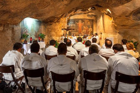 JERUSALEM, ISRAEL - JULY 13, 2014: Franciscan monks at the mass in Grotto of Gethsemane - chapel located in the cave near the Tomb of the Virgin Mary. This is the place where Judas Iscariot betrayed Jesus.